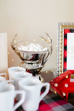 hot-chocolate-bar-marshmallows-in-silver-deer-tin http://itgirlweddings.com/flannel-themed-bachelorette-party-weekend/