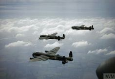 Three Lancasters of No. 44 Squadron, Royal Air Force, based at Waddington, Lincolnshire, flying above the clouds, 1942. #WWII #RAF #WW2