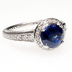 OH MY GOSH!!! I can has?! I know I said I wanted a simple band but this is beautiful... Plus big diamonds are overrated. Sapphires on the other hand? GORGEOUS!! :)