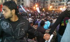 Christians faced outward and joined hands in a circle to protect a Muslim group of protesters as they prayed in Egypt during uprisings in Cairo, Egypt 2011.
