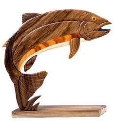 This Rainbow Trout Wood Intarsia Table Decor Sculpture is beautifully hand-crafted and looks great sitting anywhere in the home. Fish Sculpture, Wood Sculpture, Wooden Rainbow, Intarsia Patterns, Wood Fish, Ceramic Fish, Wood Carving Patterns, Intarsia Woodworking, Wooden Animals