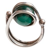 "559. Art Smith, (1917-1982), ring, Brooklyn, NY, silver and malachite, marked 1""w x 1.25""l, Lot accompanied by one copy of the Brooklyn Museum catalog, From the Village to Vogue: the Modernist Jewelry of Art Smith $800 - $1,100 More Information"