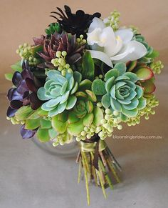Succulent Bouquet by bloomingbrides. Perfect for a Southern California bride. I'm fairly certain everything in this bouquet could be found in my parents backyard