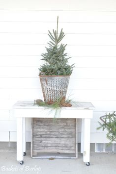 Our front porch...a fresh tiny tree in an olive basket on a handmade coffee cart. Farmhouse, vintage, country style. Buckets of Burlap