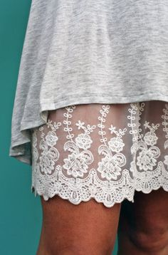 white lace slip . Can probably find one at thrift store. To extend dresses and skirts.