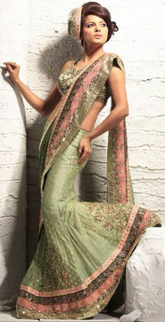 Light Green Color lehenga saree fabricated on Net