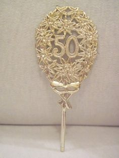 50th anniversary gold picks - Pretty for party if we decide to do something in town