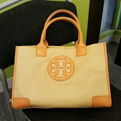 Tory Burch Ella Mini Tote in Tan Tory Burch Ella Mini nylon  and faux leather . Lightweight,  design accented in front patent leather,  magnetic snap closure, 1 inside zip pocket and 2 inside open, used  during one  summer season, great condition,  like new except for a  teeny tiny scratch in one corner,  love this bag but have to make room and organize closet.. Tory Burch Bags Totes