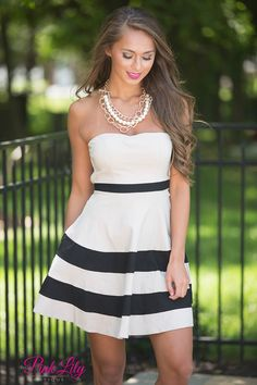 We're sure this classic dress is what you've been looking to add to your summer wardrobe - it's strapless and so easy to wear all summer long! This dress features bold black and beige stripes, a sweetheart neckline, and fabric that is lightweight without being sheer. There's also elastic at the bust and a zipper in the back.