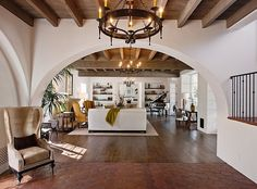 Love the arched doorway and beamed ceiling. This is the entryway in my dream house.