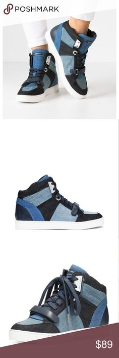 """MICHAEL Michael Kors Ollie High Top Denim Sneaker MICHAEL Michael Kors Ollie High Top Denim Sneaker Women's Shoes Blue 8.5 $195 Brand New without Box   MICHAEL Michael Kors Ollie High Top Denim Sneaker Women's Shoes Blue 8.5 MSRP $195 UPC# 1712967  MICHAEL Michael Kors colorblock denim high-top sneaker with leather trim.  1"""" flat heel.  Reinforced round toe.  Lace-up front with grip strap and logo plate detail.  """"Ollie"""" is imported.  Padded footbed.  Rubber outsole. Michael Kors Shoes Ankle…"""