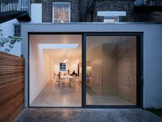 London maisonette gets bright and airy extension - Curbedclockmenumore-arrow : A simple plywood unit makes up the kitchen, storage, and a staircase