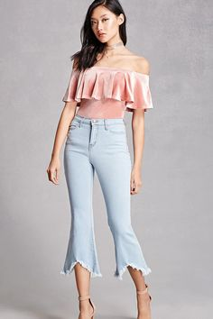 A pair of jeans featuring a flared leg, frayed uneven hem, a four pocket construction, and a zip fly. This is an independent brand and not a Forever 21 branded item.