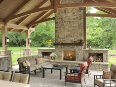 The outdoor living space includes fabulous millwork, a beautiful stone fireplace. The outdoor livi Outdoor Living Areas, Outdoor Spaces, Living Spaces, Outdoor Decor, Outdoor Ideas, Outdoor Lighting, Best Kitchen Design, Outdoor Kitchen Design, Kitchen Designs