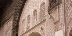 Ben Youssef - A portrait - Cereal CARRARA MARBLE PILLARS AND INTRICATE STUCCO ARCHWAYS FRAME A SEA OF COLOURED MOSAICS; MUTED GREENS, ONCE VIBRANT YELLOWS, AND WASHED OCEAN BLUES in Marrakesh