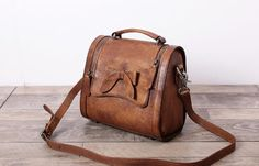 Leather Satchel Bag Doctor Bag Messenger Shoulder Bag We use genuine cow leather, quality hardware and fabric to make the bag as good as it is. •Comfortable Shoulder Strap. • Inside zipper pocket, cel