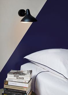 The Mantis Wall Lamp by DCW éditions Paris strikes a balance between whimsy and practicality. This fixture boasts a thin steel body with full 360-degrees rotation from its base, while an intentionally misshapen lampshade acts as the head. The shade itself helps to create a focused and direct light wherever it's pointed. This piece is simple enough in overall design that it can be easily affixed in most modern homes, functioning best in bedrooms or living rooms.