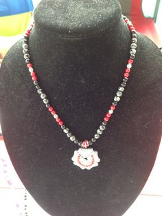 Let her make you one...she does awesome work! :)  Shamrock spur rowel, with Red crystals necklace.  Info: alet22@bellsouth.net