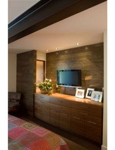 Love the built in dresser and dark wall with tv