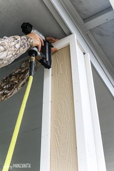 Nailing pre-primed trim pieces to porch posts for added curb appeal! Learn how t… Nailing pre-primed trim pieces to porch posts for added curb appeal! Front Porch Posts, Front Porch Columns, Deck Posts, Wood Columns, House With Porch, House Front, Concrete Porch, Building A Porch, Diy Porch