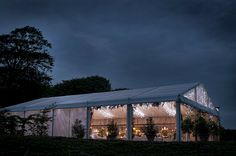 Wedding Marquee lit up with fairy lights in the evening at Trevenna Barns
