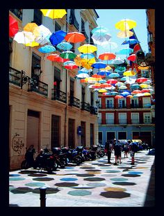 Urban art colorful umbrellas installation in Spain, Valencia, Spain. Umbrella Art, Under My Umbrella, Umbrella Street, Alicante, St Pierre, Parasols, Light Installation, Art Installations, Artistic Installation