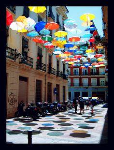 Urban art colorful umbrellas installation in Spain, Valencia, Spain. Umbrella Art, Under My Umbrella, Umbrella Street, St Pierre, Parasols, Light Installation, Art Installations, Artistic Installation, Spain And Portugal