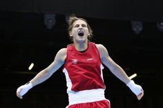 Ireland's Katie Taylor reacts as she is declared the winner over Russia's Sofya Ochigava after their Women's Light (60kg) gold medal boxing match