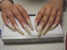 long fingernails resting on a