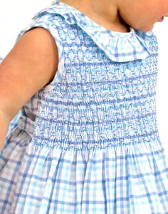 Our favorite Ruffle Cristina dress is back for spring in a classic sky blue plaid. This dress features gorgeous, geometric smocking all done by hand. You will cherish this timeless dress forever.  *Baby sizes (0m, 3m, 6m, 9m, 12m, 18m, 24m) available in our Baby Dresses category.