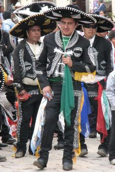 Traditonal outfits usually worn in Mexican bands.. Status-Who they are  Identification-Different bands wear different outfits  Career-Dress up when performing  Decoration-Easy on the eye  Occasion-Performances  Religion-Mexicans usually wear