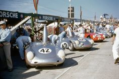 Porsche pits at Sebring featuring a group of Porsche 550 RS. Cars 44 and 45 would finish in the top ten and win the Index of Performance.