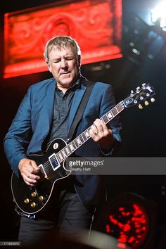 Alex Lifeson of Rush performs at the First Midwest Bank Amphitheatre on June 28, 2013 in Tinley Park, Illinois.