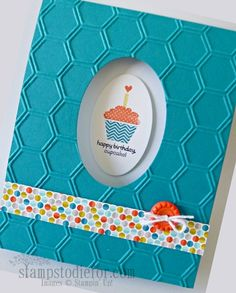 handmade card ... luv the look of turquoise and white with a tiny punch of orange ... embossed hexagon texture ... like the oval space opening to the oval image inside ...