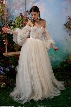 18 Fairytale Wedding Dresses for an Enchanted, Whimsical Look is part of Wedding dress trends - Traditional lace no more! Pearlescent colors, florals, and floaty fabrics are just some of the details we're loving on these modern fairytale wedding dresses Fairy Wedding Dress, Fairytale Dress, Fairy Dress, Wedding Dress Trends, Dream Wedding Dresses, Wedding Gowns, Prom Dresses, Whimsical Wedding Dresses, Princess Fairytale