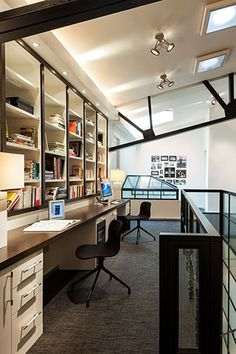 POWELL & BONNELL | Mezzanine office space with skylights in a renovated 19th century building.