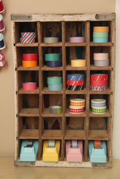 a coke crate with cubbies and fun (vintage?) different colored tape dispensers for washi tape storage!!!!!