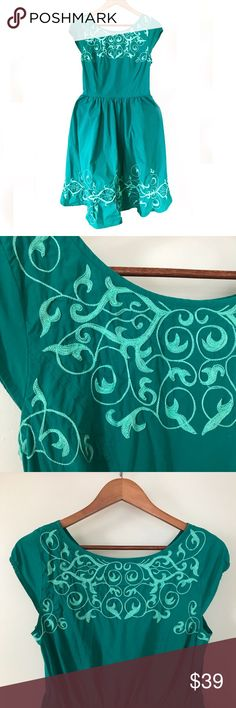 "eShakti Teal Vine Embroidered Poplin Midi Dress eShakti teal Graphic floral vine embellished poplin midi dress with cap sleeves. Beautiful light teal floral vine embroidery on a dark teal background. Modest, comfortable, and flattering. • Excellent condition • Scoop Neck, Cap sleeves, and pockets • Approx. measurements when laid flat: 16"" elastic waist, 20"" bust, 42"" length eshakti Dresses Midi"