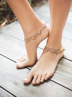 Raindrops Anklet Set | Pair of matching anklets featuring chain metal with charm detailing. Bell accents by the lobster clasp closure. *By Free People