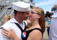 NORFOLK, VA. (Sept. 13, 2013) Cryptologic Technician (Technical) 2nd Class Connor Magnoli, kisses his wife Tina, the traditional first kiss, after USS Mahan (DDG 72) pulled into her homeport of Norfolk, Va. Mahan returned after an eight-and-a-half month deployment to the 6th Fleet area of responsibility. (U.S. Navy photo by Mass Communication Specialist 2nd Class Josue L. Escobosa/ Released)