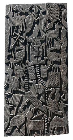 Nupe doors, Nigeria. Made of joined plank-like panels, embellished with carved reliefs of animals, objects and symbols.
