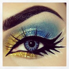 Dramatic blue and gold eye makeup
