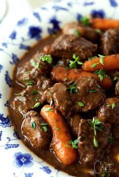 Beef Daube - it's beef stew, Provencal style! Made with red wine, rosemary, thyme and bay leaves, it's slow roasted till all the flavors meld together and the beef is melt in your mouth tender and crazy delicious!