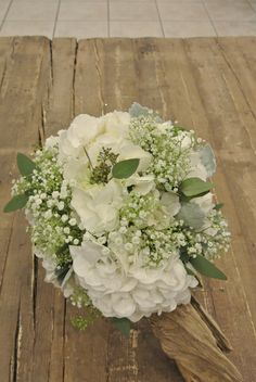 Bridal bouquet with hydrangea, baby's breath and seeded eucalyptus. Designed by Forget-Me-Not Flowers