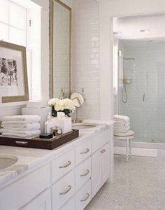 Simple & elegant white bath. Love the white subway tile.