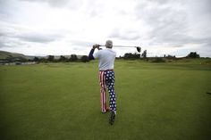 Eric Frost, who is on a golfing holiday from Freeland, Michigan, U.S., poses for a photograph as he hits a tee shot on the King's course at Gleneagles in Perthshire, Scotland, August 19, 2014. REUTERS/Paul Hackett
