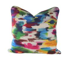 The abstract ikat pattern on this pillow cover has the look of a watercolor artists brush strokes. Colors include sky blue, turquoise, navy blue, hot pink, purple, kelly green, emerald green, brown, rust, red, maroon, orange, yellow, and gold, on a natural linen background.  Wate...