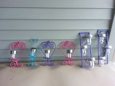 A Charming (and Cheap!) Way to Light up Your Outdoors-spray paint sconces and add solar lights