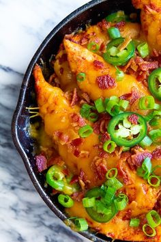 This is a carb-less play on the popular Texas Cheese Fries. I'm not a carb counter, but I'm also not a huge fry guy so, chicken seemed like a great sub.  It's also one those dishes that does great as game day grub. It hits all the necessary criteria: ooey-gooey, cheesy, loaded with bacon and it's finger food.  Or in my case, it was my second lunch. Yep. I made it with every intention of sharing with Cole as an after school snack, but got hungry and ended up eating the whole pa...