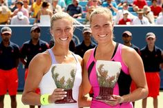 MASON, OH - AUGUST 19: Andrea Hlavackova and Lucie Hradecka of the Czech Republic pose for photographers after winning the doubles final during the Western & Southern Open at the Lindner Family Tennis Center on August 19, 2012 in Mason, Ohio.  (Photo by Matthew Stockman/Getty Images)